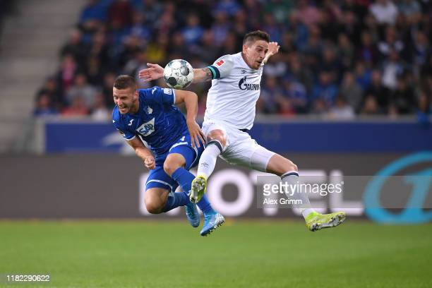 Bastian Oczipka of FC Schalke 04 battles for possession with Pavel Kaderabek of TSG 1899 Hoffenheim during the Bundesliga match between TSG 1899...