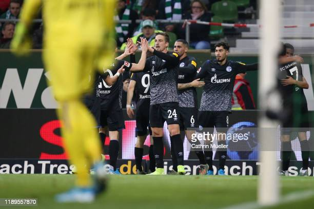 Bastian Oczipka of FC Schalke 04 celebrates with teammates after his team's first goal during the Bundesliga match between SV Werder Bremen and FC...