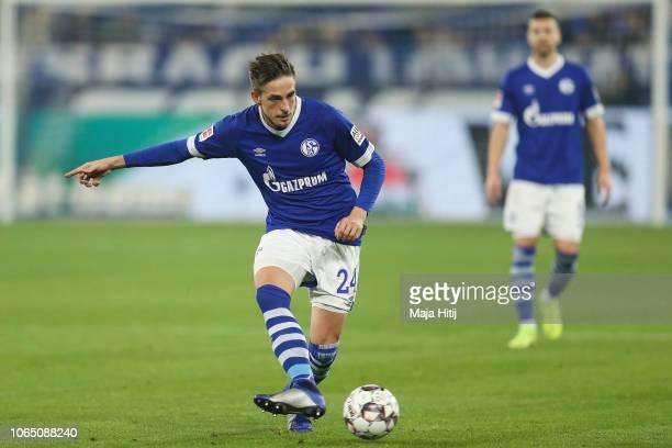 Bastian Oczipka of FC Schalke 04 controls the ball during the Bundesliga match between FC Schalke 04 and 1 FC Nuernberg at VeltinsArena on November...