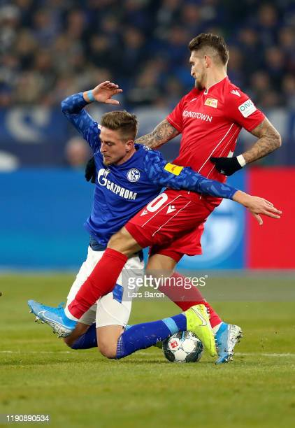 Bastian Oczipka of FC Schalke 04 is tackled by Robert Andrich of 1 FC Union Berlin during the Bundesliga match between FC Schalke 04 and 1 FC Union...