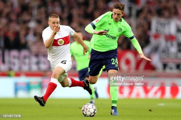 Bastian Oczipka of FC Shalke 04 is challenged by Santiago Ascacibar of VfB Stuttgart during the Bundesliga match between VfB Stuttgart and FC Schalke...