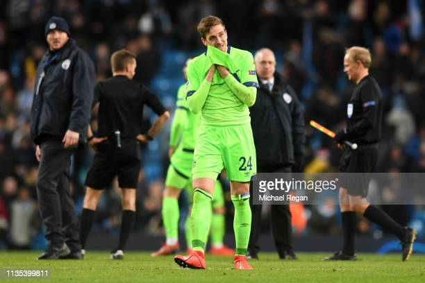 Bastian Oczipka of FC Shalke 04 reacts at the full time whistle during the UEFA Champions League Round of 16 Second Leg match between Manchester City...