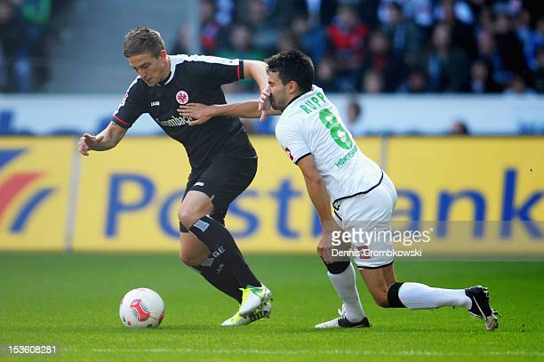 Bastian Oczipka of Frankfurt and Lukas Rupp of Moenchengladbach battle for the ball during the Bundesliga match between VfL Borussia Moenchengladbach...