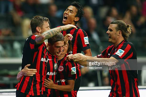 Bastian Oczipka of Frankfurt celebrates his team's third goal with team mates Marco Russ Takashi Inui Makoto Hasebe and Alexander Meier during the...