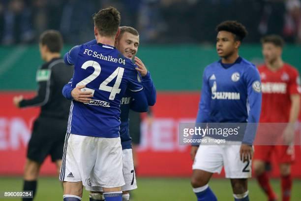 Bastian Oczipka of Schalke 04 Max Meyer of Schalke 04 celebrates the victory during the German DFB Pokal match between Schalke 04 v 1 FC Koln at the...
