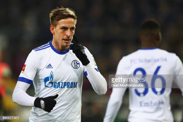 Bastian Oczipka of Schalke 04 speaks to team mate Breel Embolo during the Bundesliga match between Borussia Moenchengladbach and FC Schalke 04 at...