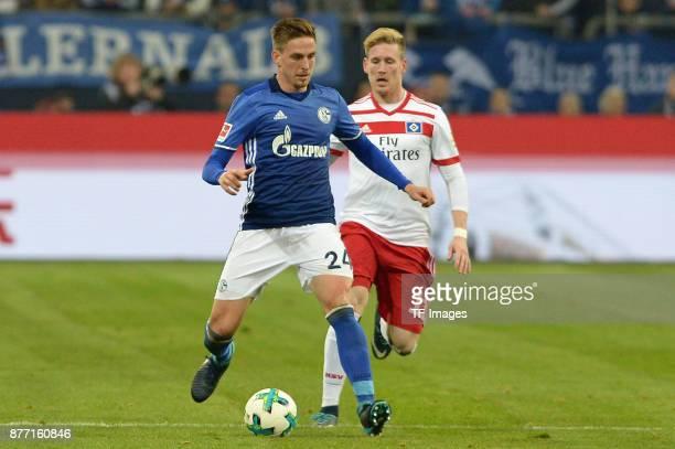 Bastian Oczipka of Schalke and Andre Hahn of Hamburg battle for the ball during the Bundesliga match between FC Schalke 04 and Hamburger SV at...
