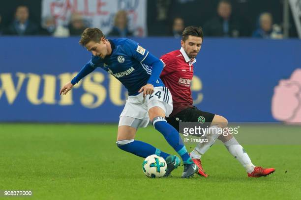 Bastian Oczipka of Schalke and Julian Korb of Hannover battle for the ball during the Bundesliga match between FC Schalke 04 and Hannover 96 at...