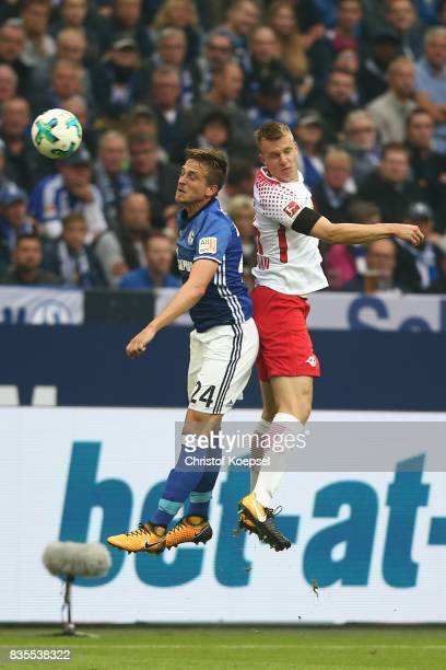 Bastian Oczipka of Schalke and Lukas Klostermann of Leipzig during the Bundesliga match between FC Schalke 04 and RB Leipzig at VeltinsArena on...