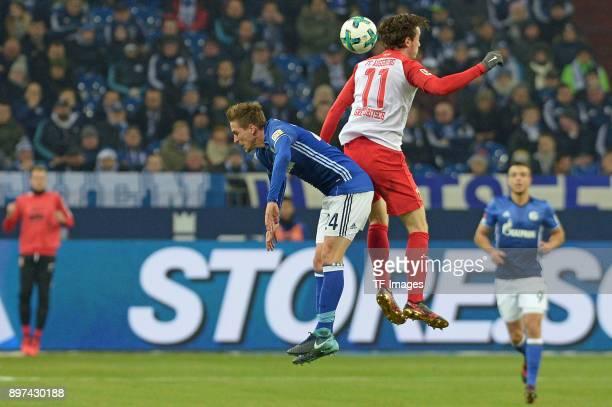 Bastian Oczipka of Schalke and Michael Gregoritsch of Augsburg battle for the ball during the Bundesliga match between FC Schalke 04 and FC Augsburg...