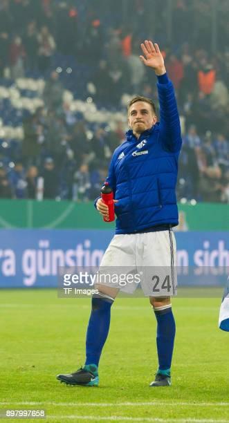 Bastian Oczipka of Schalke celebrates after winning the DFB Cup match between FC Schalke 04 and 1 FC Koeln at VeltinsArena on December 19 2017 in...