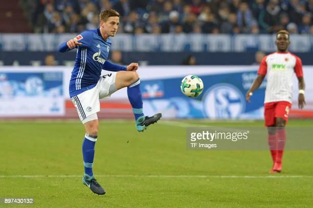 Bastian Oczipka of Schalke controls the ball during the Bundesliga match between FC Schalke 04 and FC Augsburg at VeltinsArena on December 13 2017 in...