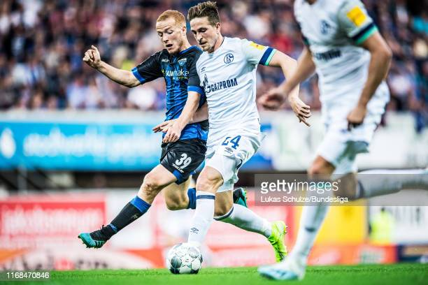 Bastian Oczipka of Schalke in action against Sebastian Vasiliadis during the Bundesliga match between SC Paderborn 07 and FC Schalke 04 at Benteler...