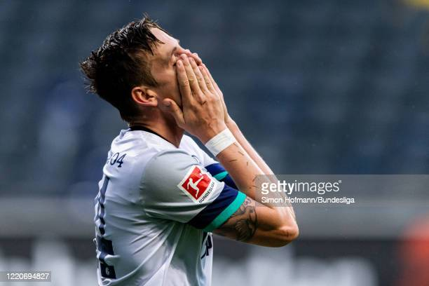 Bastian Oczipka of Schalke is disappointed during the Bundesliga match between Eintracht Frankfurt and FC Schalke 04 at Commerzbank-Arena on June 17,...
