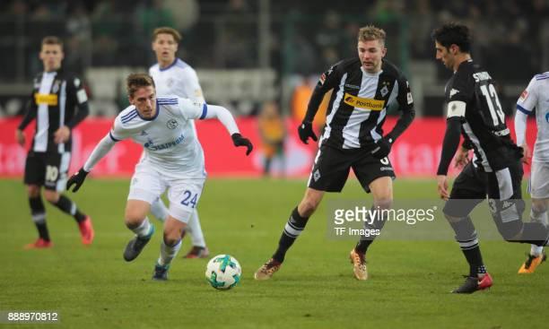 Bastian Oczipka of Schalke Lars Stindl of Borussia Moenchengladbach and Christoph Kramer of Borussia Moenchengladbach battle for the ball during the...