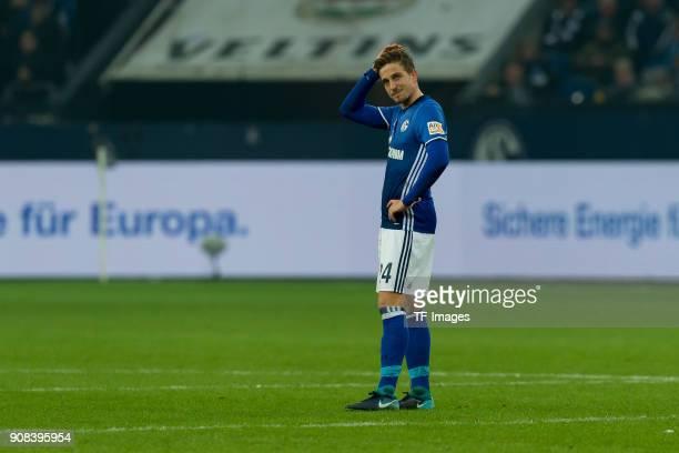 Bastian Oczipka of Schalke looks dejected during the Bundesliga match between FC Schalke 04 and Hannover 96 at VeltinsArena on January 21 2018 in...