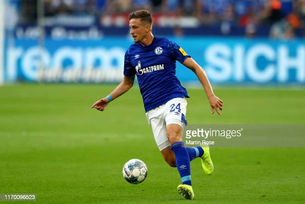 Bastian Oczipka of Schalke runs with the ball during the Bundesliga match between FC Schalke 04 and FC Bayern Muenchen at VeltinsArena on August 24...