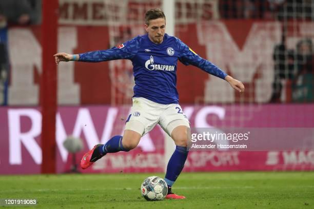 Bastian Oczipka of Schalke runs with the ball during the Bundesliga match between FC Bayern Muenchen and FC Schalke 04 at Allianz Arena on January 25...