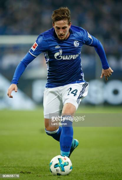 Bastian Oczipka of Schalke runs with the ball during the Bundesliga match between FC Schalke 04 and Hannover 96 at VeltinsArena on January 21 2018 in...