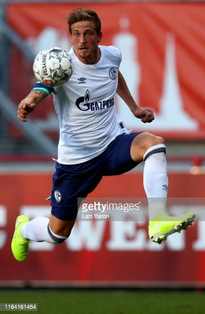 Bastian Oczipka of Schalke runs with the ball during the preseason friendly match between FC Twente and FC Schalke 04 at De Grolsch Veste Stadium on...