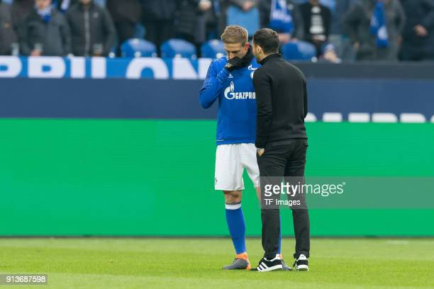 Bastian Oczipka of Schalke speaks with Head coach Domenico Tedesco of Schalke prior to the Bundesliga match between FC Schalke 04 and SV Werder...