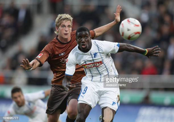 Bastian Oczipka of St Pauli and Demba Ba of Hoffenheim battle for the ball during the Bundesliga match between FC St Pauli Hamburg and1899 Hoffenheim...