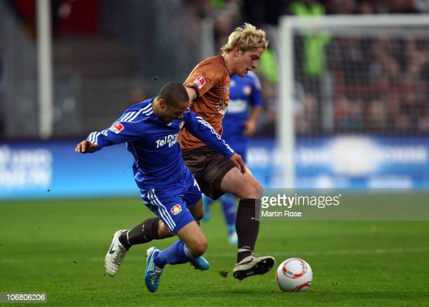 Bastian Oczipka of St Pauli and Sidney Sam of Leverkusen battle for the ball during the Bundesliga match between FC St Pauli and Bayer Leverkusen at...