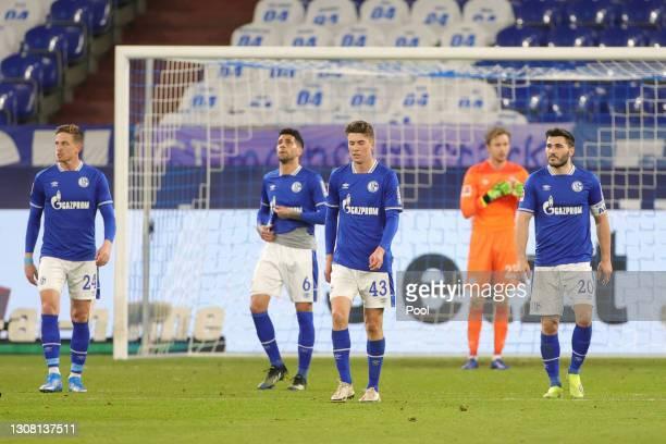 Bastian Oczipka, Omar Mascarell, Matthew Hoppe and Sead Kolasinac of FC Schalke 04 react after conceding during the Bundesliga match between FC...