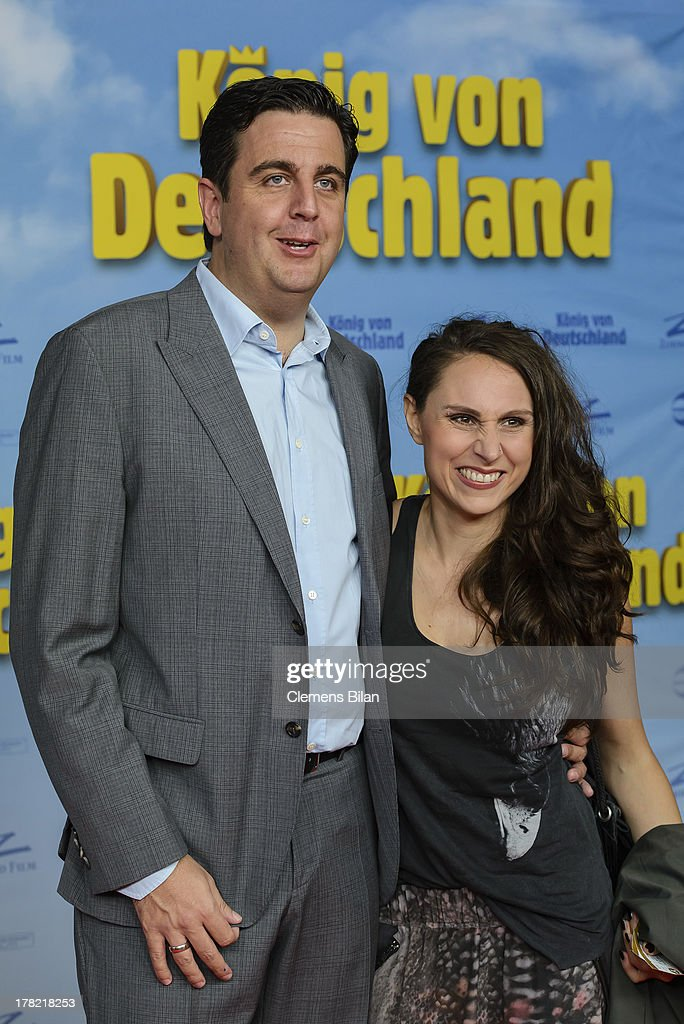 Bastian Pastewka (L) and Heidrun Buchmaier attend the 'Koenig von Deutschland' Berlin premiere at Kino International on August 27, 2013 in Berlin, Germany.