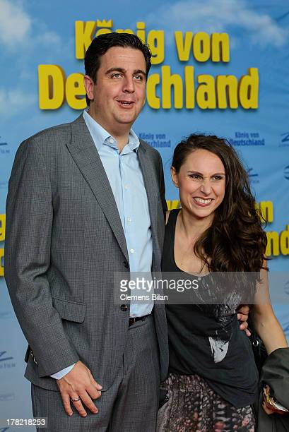 Bastian Pastewka and Heidrun Buchmaier attend the 'Koenig von Deutschland' Berlin premiere at Kino International on August 27, 2013 in Berlin,...