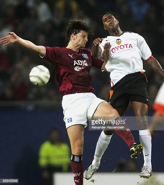 Bastian Reinhardt of Hamburg goes up for a header with Patrick Kluivert of Valencia during the Intertoto Cup Final between Hamburger SV and FC...