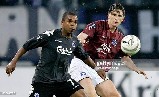 Bastian Reinhardt of Hamburg tussels for the ball with Alvaro Santos of Kopenhagen during the UEFA Cup match between Hamburger SV and FC Kopenhagen...