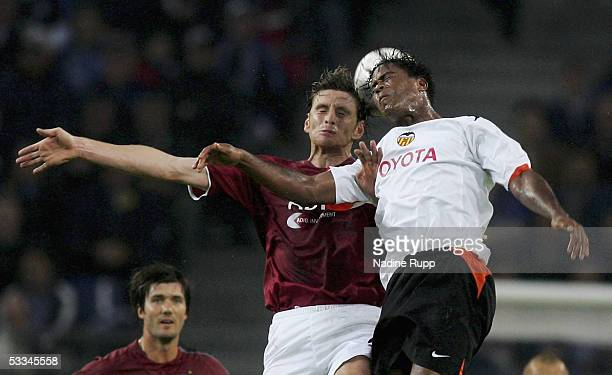 Bastian Reinhardt of HSV competes with Patrick Kluivert of Valencia during the Intertoto Cup Final between Hamburger SV and FC Valencia at the AOL...