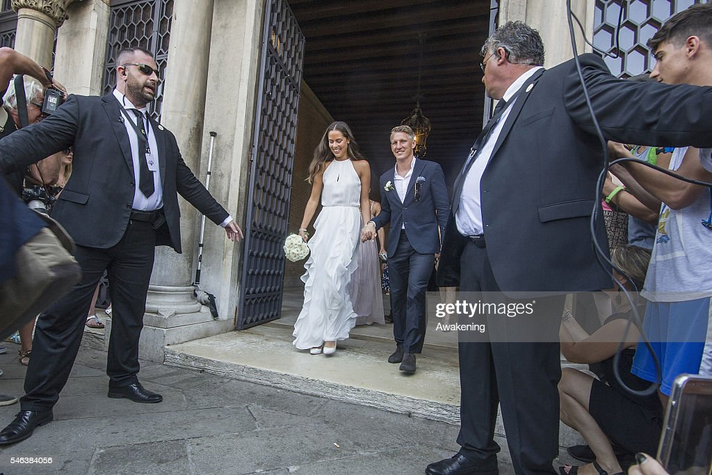 Bastian Schweinsteiger and Ana Ivanovic come out of the wedding hall at Palazzo Cavalli after the celebration of their marriage on July 12, 2016 in Venice, Italy.