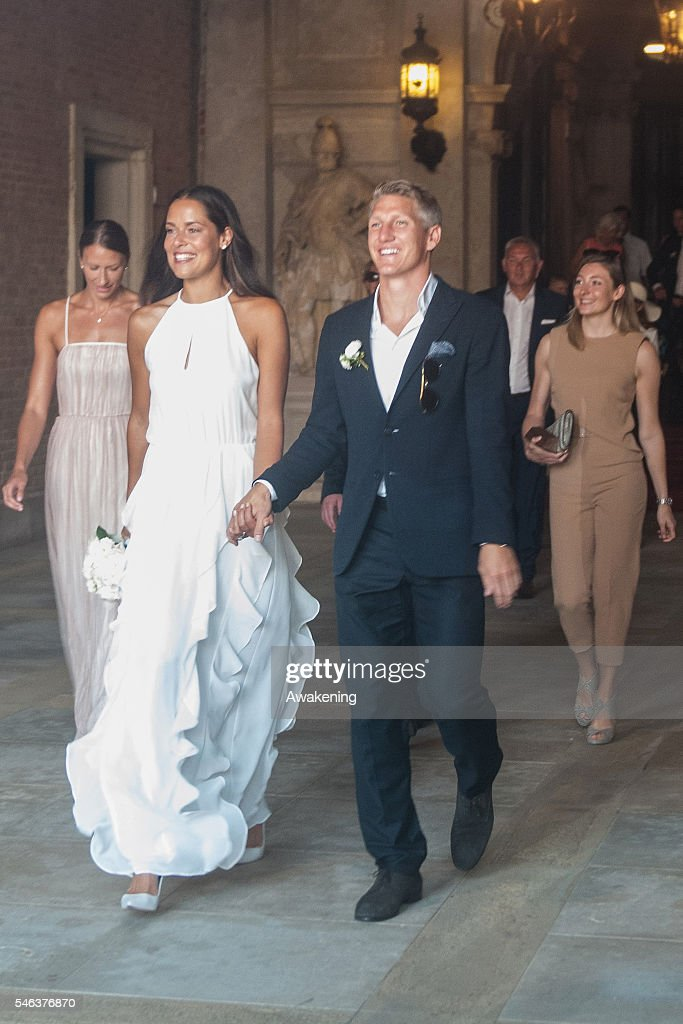 Bastian Schweinsteiger and Ana Ivanovic followed by Miroslava Najdanovski (L) come out of the wedding hall at Palazzo Cavalli after the celebration of their marriage on July 12, 2016 in Venice, Italy.