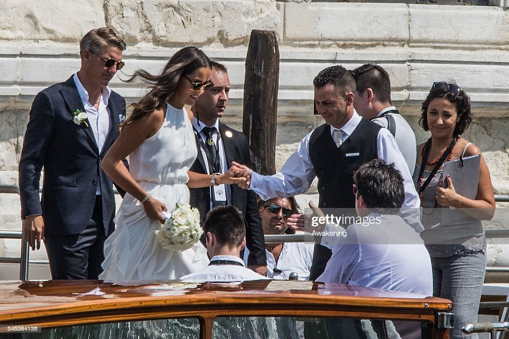 Bastian Schweinsteiger and Ana Ivanovic leave the Aman Grand Canal hotel to reach the wedding hall at Palazzo Cavalli before the celebration of their marriage on July 12, 2016 in Venice, Italy.