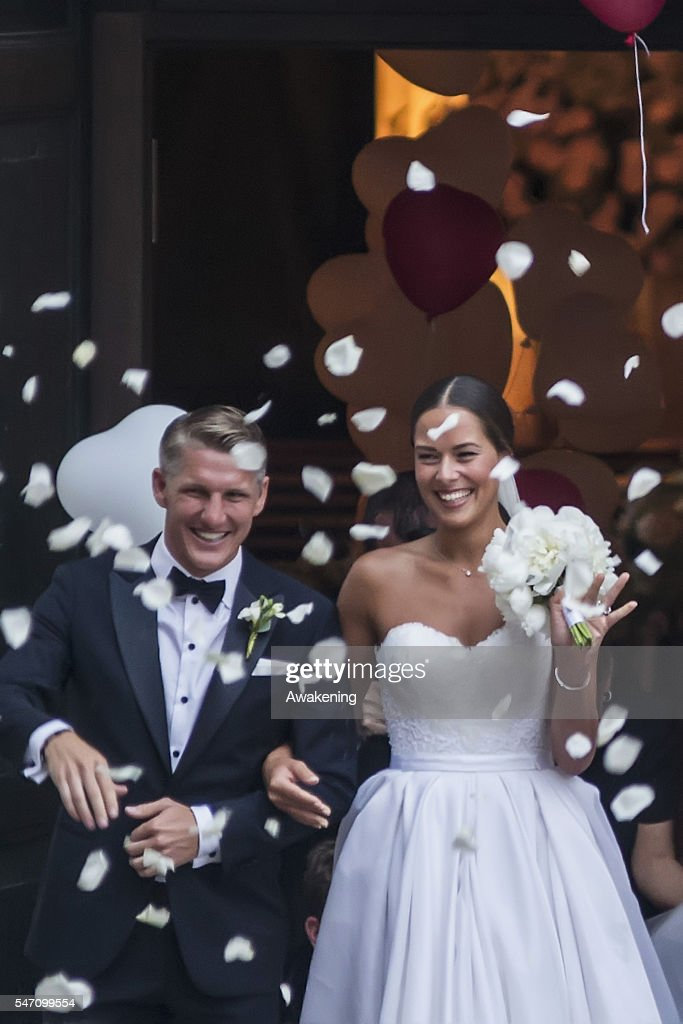 Bastian Schweinsteiger and Ana Ivanovic leave the church after their wedding on July 13, 2016 in Venice, Italy.