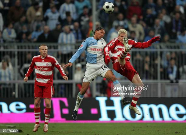 Bastian Schweinsteiger and Christian Lell of Bayern Munich in action with Jose Holebas of TSV 1860 during the friendly match between FC Bayern Munich...