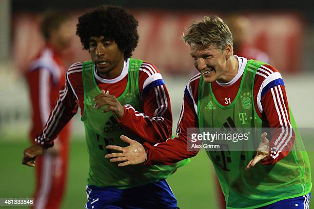 Bastian Schweinsteiger and Dante react during day 3 of the Bayern Muenchen training camp at ASPIRE Academy for Sports Excellence on January 11 2015...
