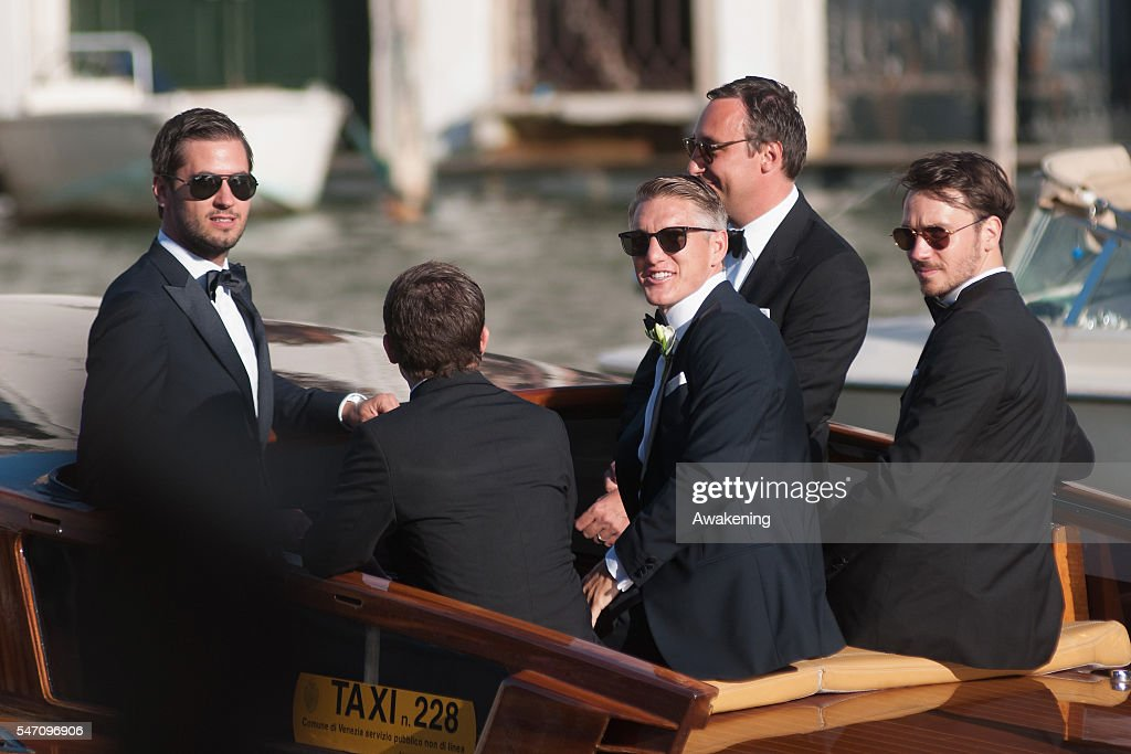 Bastian Schweinsteiger (C) and Felix Neureuther (R) travel by water taxi with friends from the Aman Grand Canal Hotel to the church for his wedding to Ana Ivanovic on July 13, 2016 in Venice, Italy.