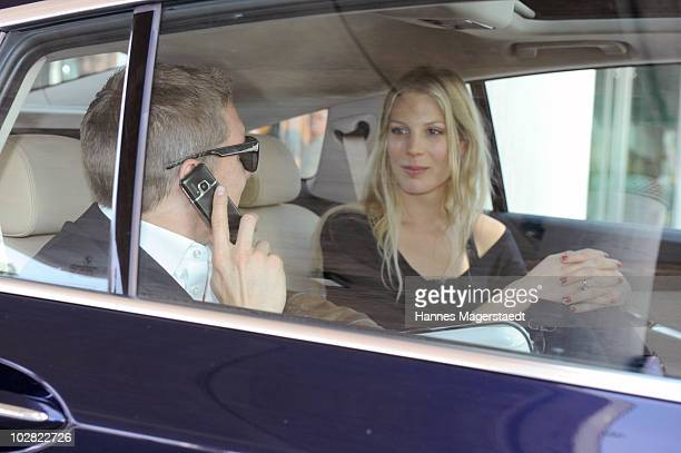 Bastian Schweinsteiger and girlfriend Sarah Brandner leave the airport during their arriving after the World Cup 2010 in Southafrica on July 12 2010...