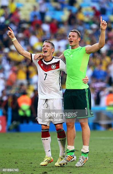 Bastian Schweinsteiger and goalkeeper Manuel Neuer of Germany celebrate victory after defeating France 10 in the 2014 FIFA World Cup Brazil Quarter...