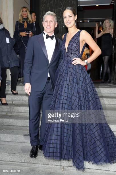 Bastian Schweinsteiger and his wife Ana Schweinsteiger arrive for the 20th GQ Men of the Year Award at Komische Oper on November 8 2018 in Berlin...