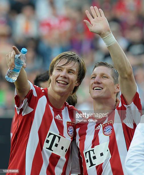 Bastian Schweinsteiger and Holger Badstube rof Muenchen smile after winning the Supercup match between FC Bayern Muenchen and FC Schalke 04 at Impuls...
