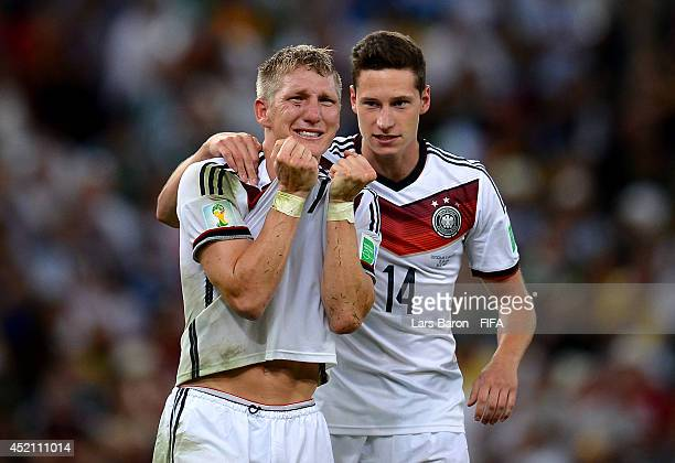 Bastian Schweinsteiger and Julian Draxler of Germany celebrate the 10 win in the 2014 FIFA World Cup Brazil Final match between Germany and Argentina...