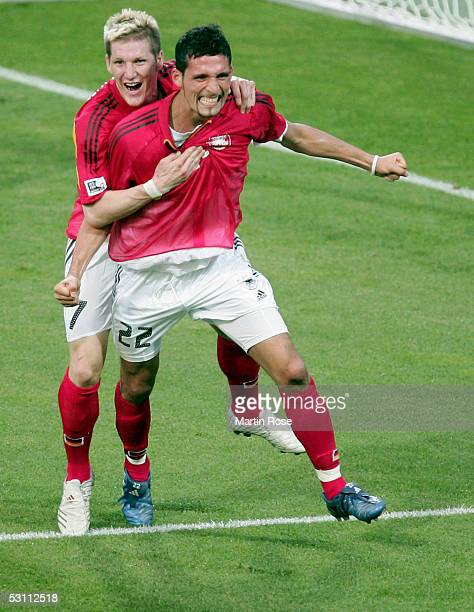 Bastian Schweinsteiger and Kevin Kuranyi of Germany celebrates scoring the first goal during the Confederations Cup 2005 match between Argentina and...