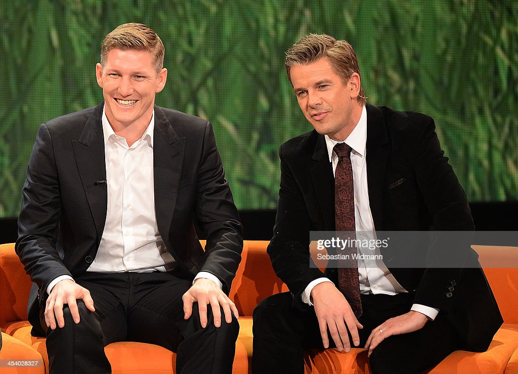 Bastian Schweinsteiger and Markus Lanz attend the taping of the 'Menschen 2013' Show on December 6, 2013 in Munich, Germany.