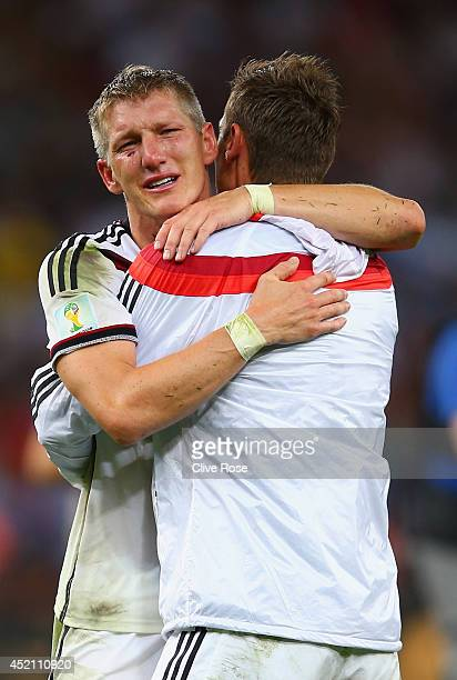 Bastian Schweinsteiger and Miroslav Klose of Germany celebrate defeating Argentina 10 in the 2014 FIFA World Cup Brazil Final match between Germany...