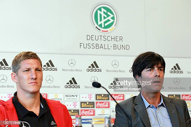 Bastian Schweinsteiger and national coach Joachim Loew attend a press conference of the German National football team at Mercedes-Benz Museum on...