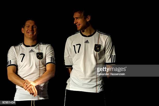 Bastian Schweinsteiger and Per Mertesacker present the new German FIFA World Cup 2010 jersey 'Teamgeist' at the adidas Brand Center on November 10...